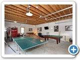 Game room in Timber Peg Lodge by Lake Norman Luxury Rentals