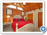 Master bedroom in Timber Peg Lodge by Lake Norman Luxury Rentals