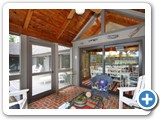 Screened porch in Timber Peg Lodge by Lake Norman Luxury Rentals