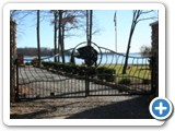 Even the gate is spectacular at Bear Creek Lodge by lake Normam rentals.