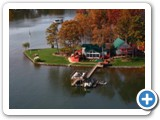 Aerial view of Bear Creek Lodge by lake Normam rentals.
